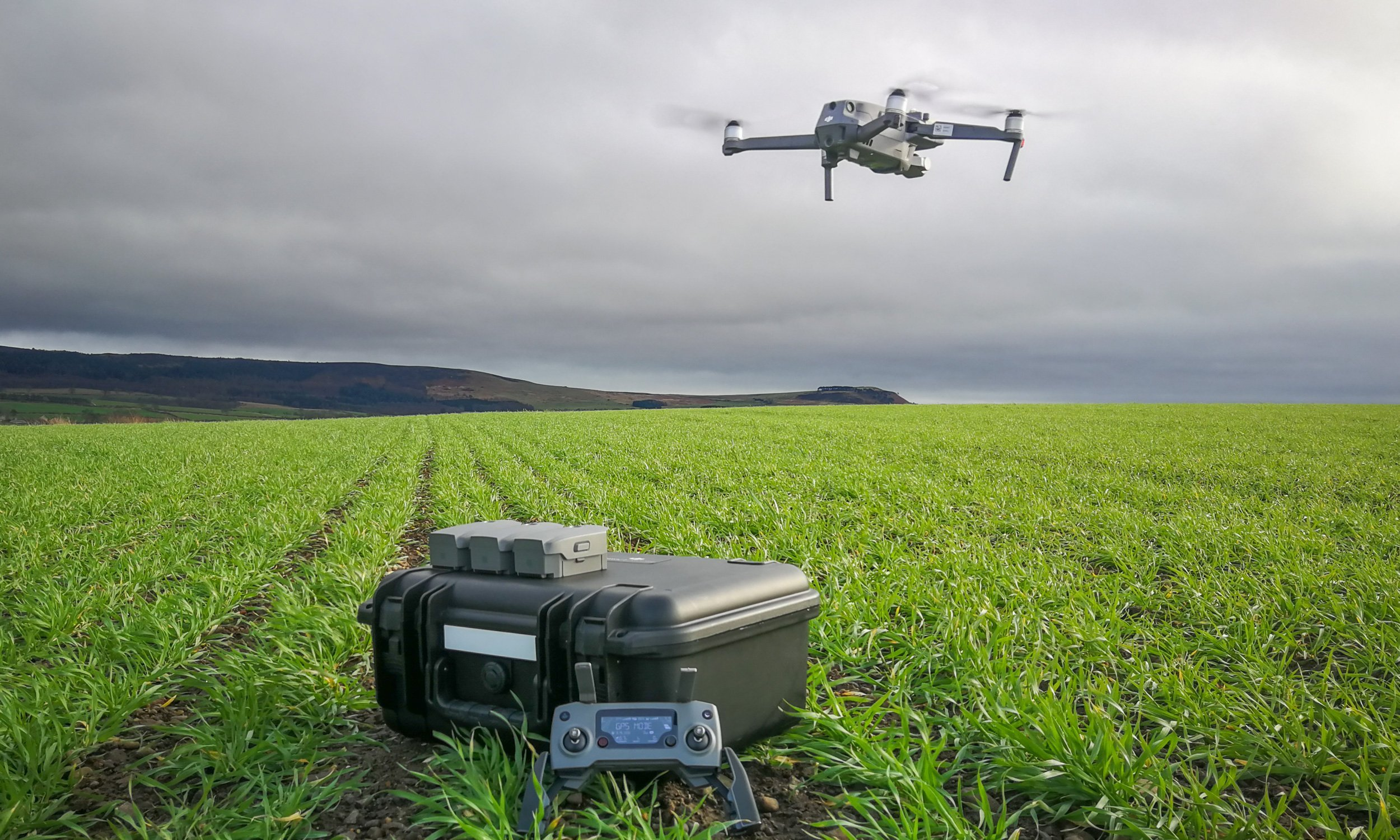 A Farmer Monitoring Crops with Drones
